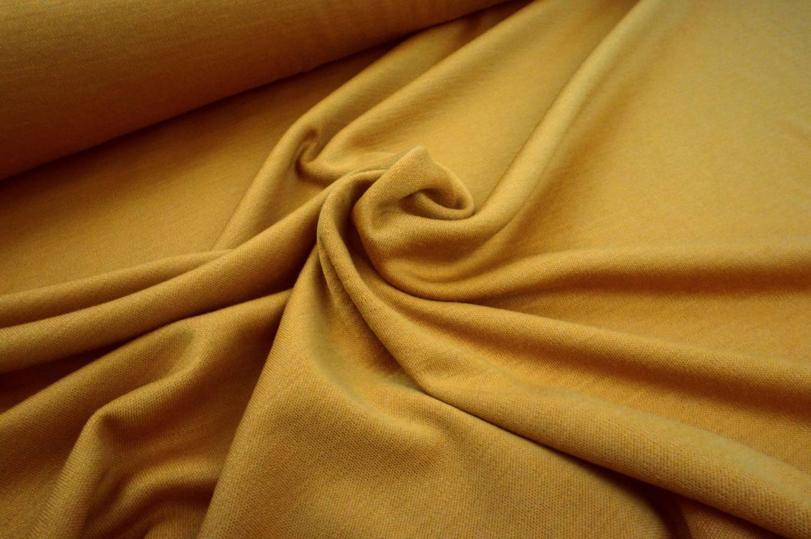 Woll Interlockjersey golden ochre
